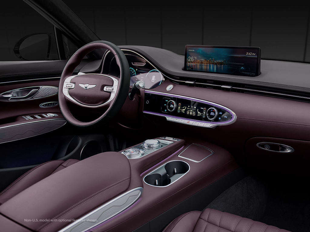 2022 Genesis GV70 interior with HD screens and ambient lighting.