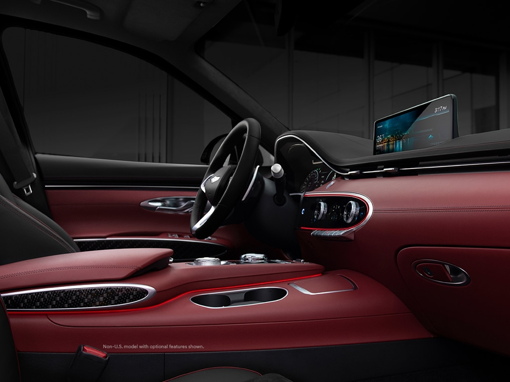2022 Genesis GV70 interior with 14.5-inch HD navigation display and available suede Nappa leather.